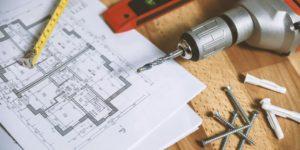 Immobilienkauf - Bauplan Bohrer Schrauben Zollstock