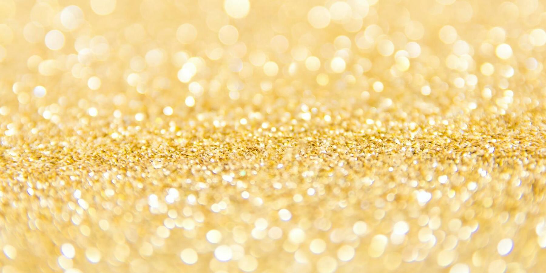 Investieren in Gold - Goldstaub auf einer Oberfläche